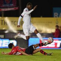 Troy Brown slides in on Christian Benteke